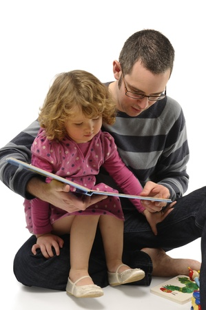 An young dad reading fairy tales to his daughter photo
