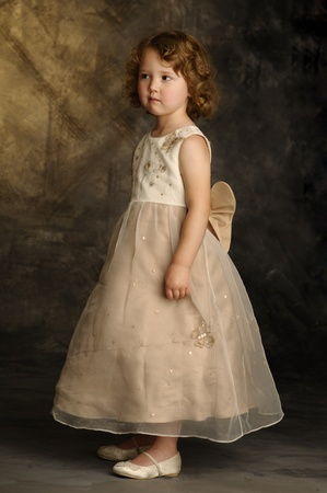 endearing: A little girl standing in Sunday dress