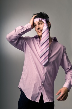drunk man: Man with tie around head and headache in morning Stock Photo