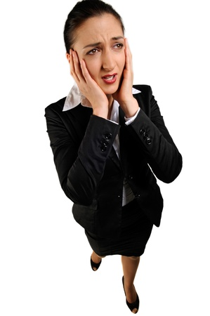Attractive young businesswoman in stress photo