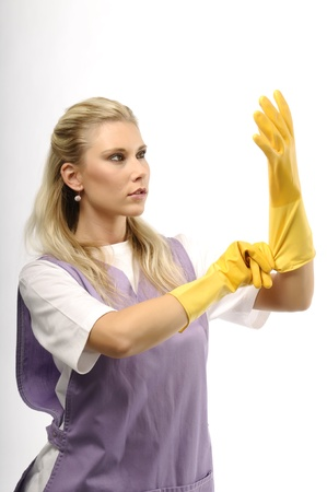 Portrait of cleaning young woman wearing yellow gloves photo