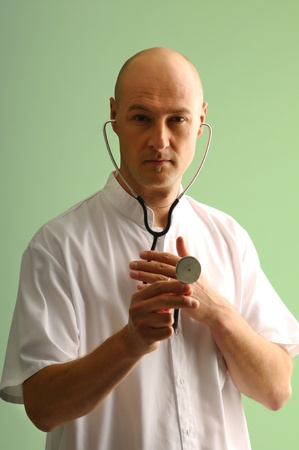 medical assistant: Portrait of medical assistant using stethoscope