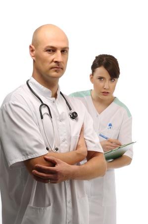 dictating: Joven m�dico dictando notas a la enfermera