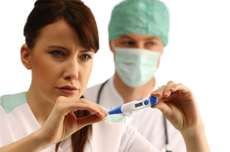 Two medical assistans holding thermometer photo
