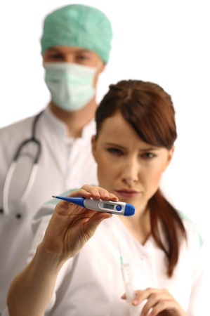 Assistant holding clinical thermometer photo