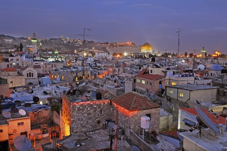 View at the old city in Jerusalem and the dome of the rock in distance photo