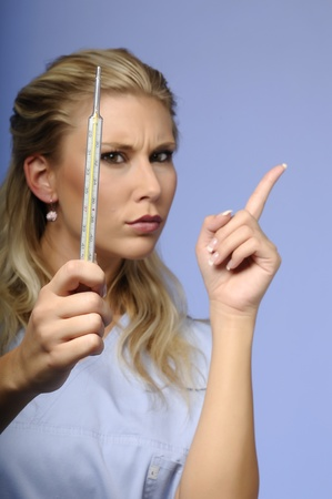 Portrait of blond girl warning with a thermometer photo
