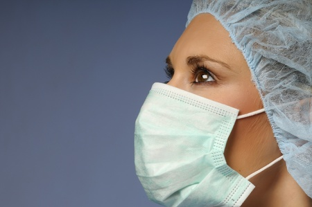 Girl with a medical cap and mask photo