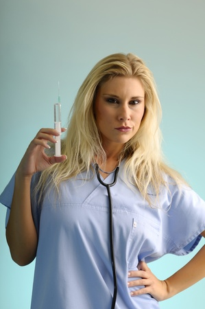 Blond girl with an injection and stethoscope  photo