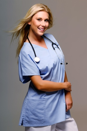 sexy female doctor: Smiling blond nurse with stethoscope around her neck  Stock Photo