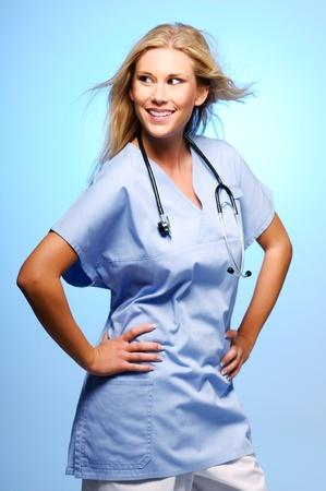 Posing blond nurse with stethoscope around her neck  photo