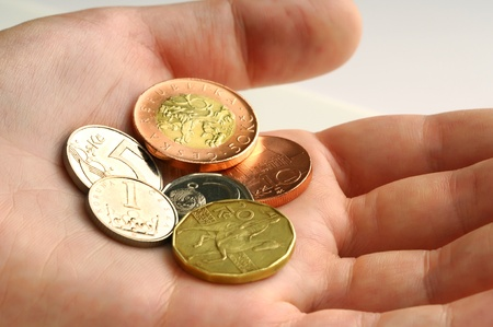 10 fingers: Czech coins of amount one, two, five,ten, twenty and fifty in a hand