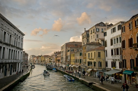 Picture of a canal and street in Venice photo
