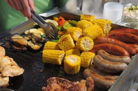 Grilled corn, sausages and meat Stock Photo