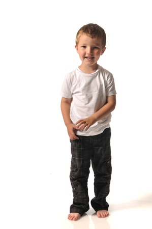 Barefoot boy in pants and white shirt