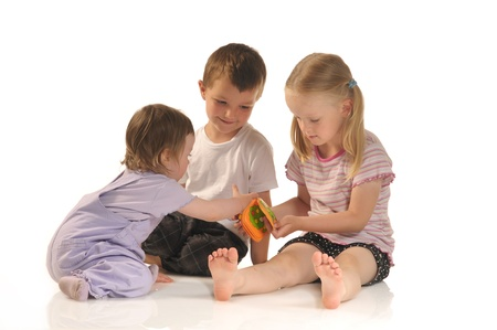 Three siblings playing together photo