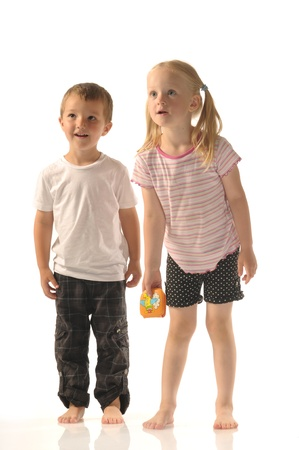 little boy and girl: Brother and his blond sister looking at something Stock Photo