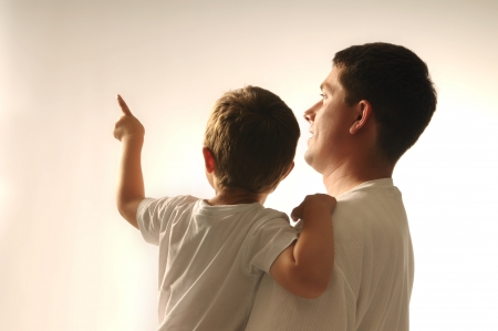kid pointing: Picture of father and his son pointing at something