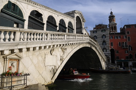 Picture of a boat and the bridge over a canal in Venice Stock Photo - 10912590
