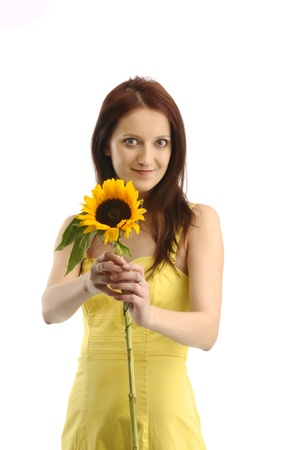 yellov: Smiling young girl in yellov dress showing a sunflower Stock Photo