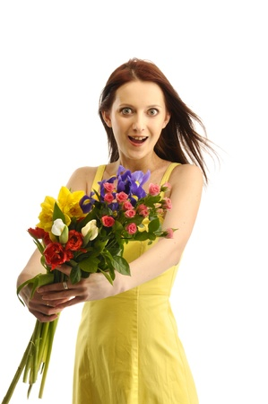 Portrait of surprised girl in yellov dress with a bunch of flowers photo