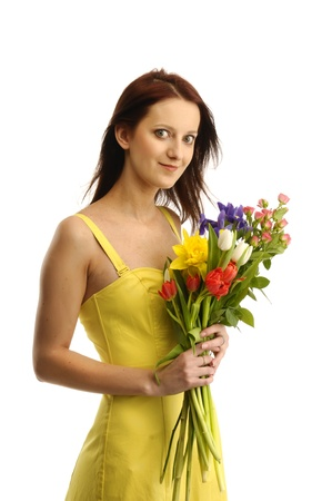yellov: Portrait of cute  girl in yellov dress with a bunch of flowers Stock Photo