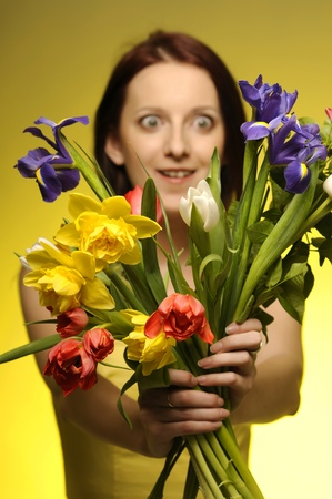 Portrait of pretty girl with a bunch of flowers photo