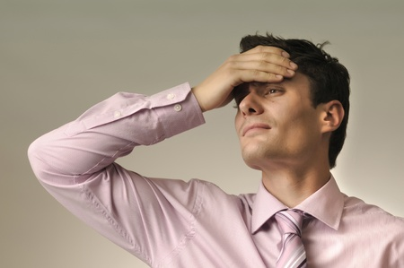 Handsome man wearing shirt and tie having an headache Stock Photo - 10921213