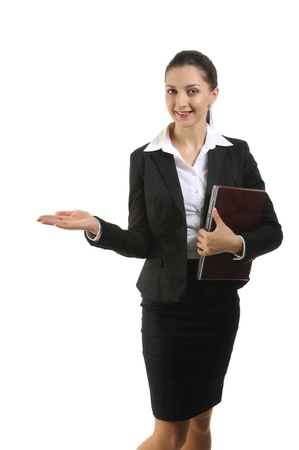 Pretty posing brunette in business costume holding laptop Stock Photo - 10895724