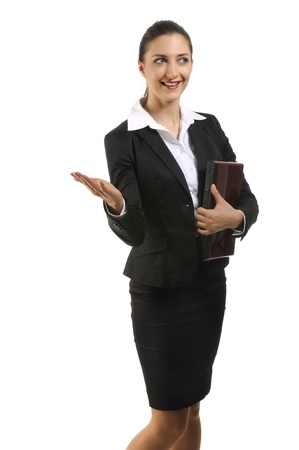 Pretty posing brunette in business costume holding laptop  Stock Photo - 10895728