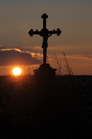 trebic: Picture of a cross and the sunset
