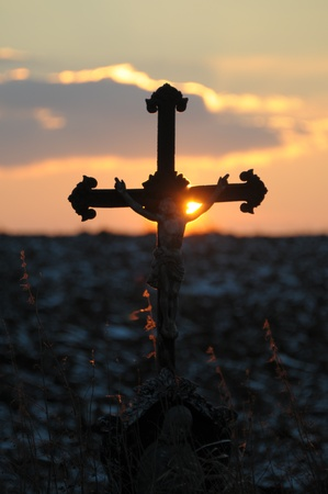Picture of a cross and the sunset