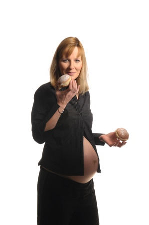 pregnant women donuts: Picture of a young pregnant woman holding donuts in her hands