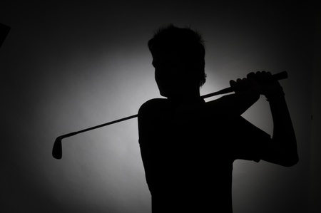 Picture of a shilhouette of person playing golf photo