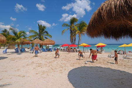 People playing soccer on the beach of Mahahual in Mexico