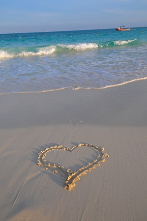 Picture of heart made in sand in Playa del Carmen beach photo