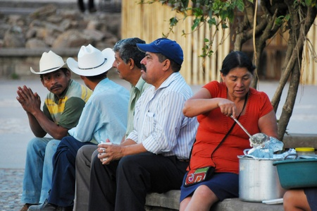 honduras: Four men and a woman siiting on the bench in Copan