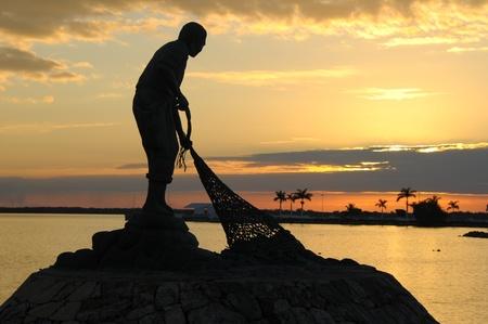 Picture of a statue of fishman in Chetumal coast Standard-Bild