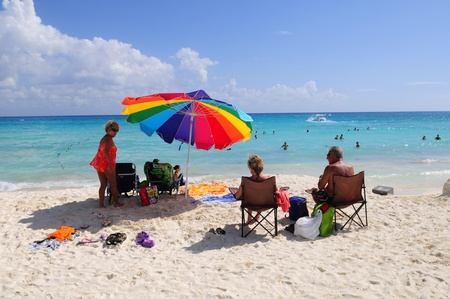 Tourists enjoying sun on beach of Playa del Carmen in Mexico