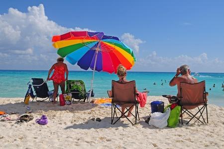 carmen: Tourists enjoying sun on beach of Playa del Carmen in Mexico Editorial