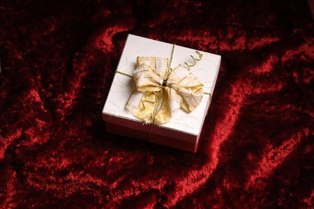 obliged: Gift on red background Stock Photo