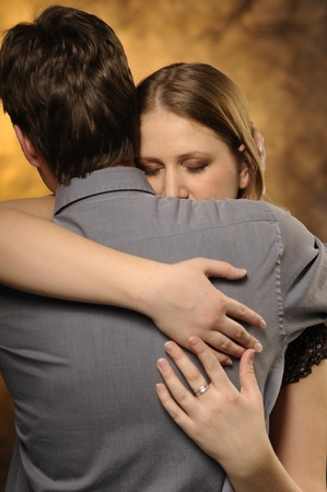 Couple in an embrace on an orange background Stock Photo - 11012566