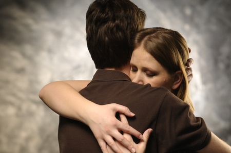 Couple in an embrace on an gray background Stock Photo - 11012554