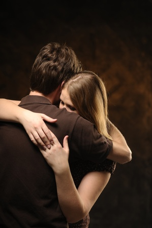 atone: Couple in an embrace on an flamy background