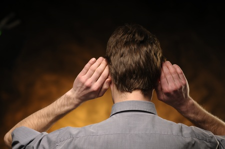 Man in shirt from behind with hands on ears Stock Photo - 11012550