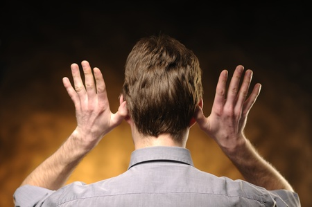 Man in shirt from behind with hands on ears Stock Photo - 10730945