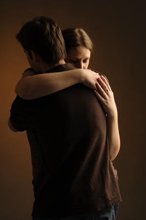 Couple in an embrace on an dark background Stock Photo - 10730938
