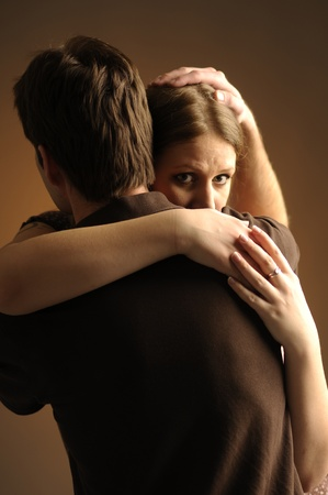 Couple in an embrace on an dark background Stock Photo - 11012548