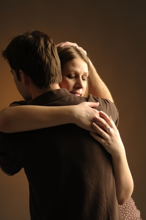 Couple in an embrace on an dark background Stock Photo - 10730939