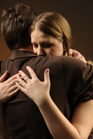 Couple in an embrace on an dark background Stock Photo - 11012556